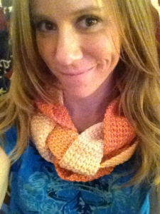 Wearing one of the braided crocheted infinity scarves that I made to raise money for ATCP.